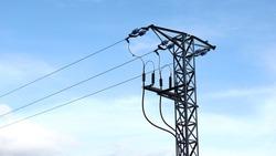 medium voltage electric tower against blue background