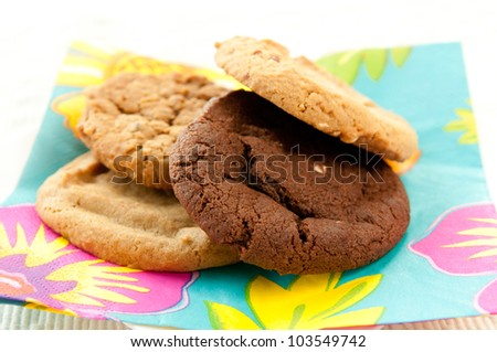 medley of tasty decadent cookies including chocolate chip, raisin, oatmeal and peanut butter