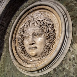 Medusa face sculpture. Head portrait of MedusaIn Greek mythology Medusa was a monster, a Gorgon, a winged human female with a hideous face and living venomous snakes in place of hair