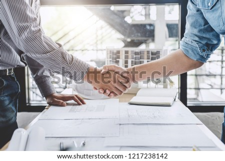 Meeting and greeting, Two engineer or architect meeting for project, handshake after consultation and conference new project plan, contract for both companies, success, partnership. #1217238142