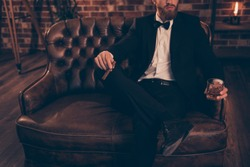 Meeting bar restaurant posh rich wealthy rest relax leisure lifestyle weekend look financier concept. Photo of serious virile masculine successful powerful elegant handsome economist sitting on divan