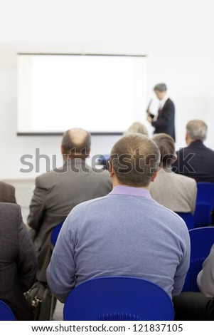 Meeting in a conference hall.