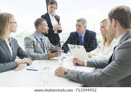 Meeting of business partners using laptops and talking at the table #713394952