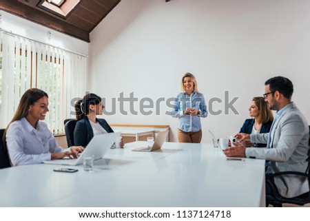 Meeting of executives in a boardroom.