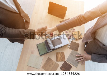 Meeting of Insurance agent and customer shaking hands after signing a contract for realty purchase in office .Bank employee congratulate.Home loan approval ,insurance mortgage, real estate concept #1284354226