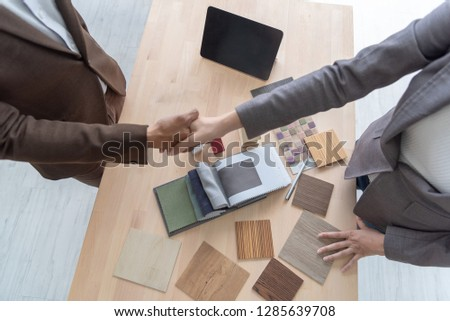 Meeting of Insurance agent and customer shaking hands after signing a contract for realty purchase in office .Bank employee congratulate.Home loan approval ,insurance mortgage, real estate concept #1285639708