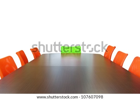 Meeting room with brown table , orange armchairs , television and wood wall. Office interior