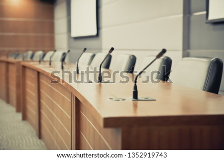 Meeting room with Professional  Microphone on the Table.