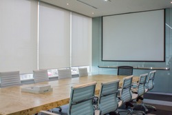 Meeting room with white curtain, shutters, blind, roller.