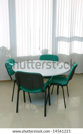 meeting table and 4 chairs near window