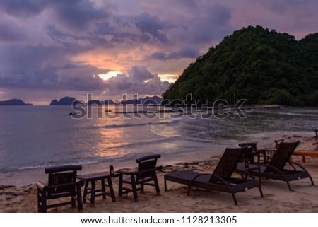 Stock Photo Meeting the sunset on the Las Cabanas beach - El Nido Palawan, Philippines