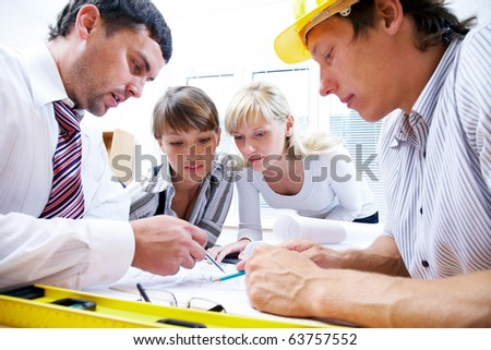 Meeting the team of engineers working on a construction project at the table