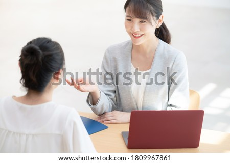 Meeting young asian women in the room. Consultant.