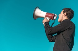 megaphone as a tool for loud communication of important news and information. Copy space. Isolated