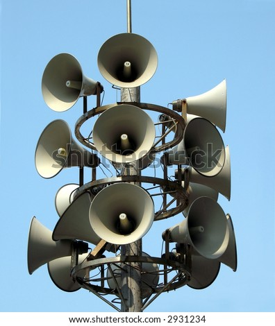 Megaphone Tower -- three megaphones point in each direction to announce warning messages