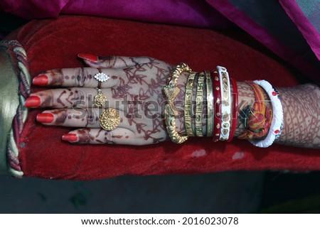 Mehendi on beautiful lady hands with dark background. Wedding mehendi, festival mehendi in India. Stock photo ©