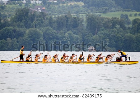 MEILEN - JUNE 12: Athletes fight hard for victory and had fun at the dragon boat racing festival June 12, 2010 in Meilen, Switzerland. Participants were also staff from institutes of EMPA and ETH