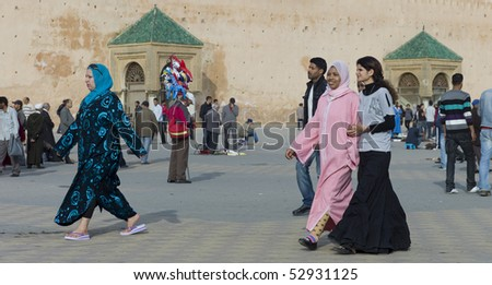 MEKNES - APRIL 18: Arabic women walking on square near he city wall in Meknes in the afternoon April 18, 2010 in Meknes, Morocco.
