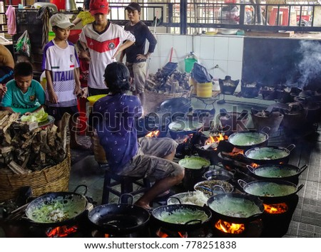 Mekong Delta, Vietnam - Sep 2, 2017. Khmer people cooking traditional pancake at local restaurant in Mekong Delta, Vietnam. #778251838
