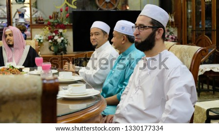 Melaka, Malaysia- 22 July 2017:Scenery at Hari Raya(Eid Mubarak).People gathering at Bukit Katil,Melaka. for a Eid Mubarak celebration. Image contain certain grain or noise and soft focus. #1330177334