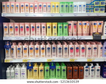 MELAKA,MALAYSIA-OCTOBER 26, 2018: Close up view of  Vaseline lotion products stacked on a shelf in a supermarket. #1213610539