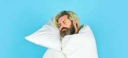 Melatonin makes you feel drowsy and helps you stay asleep. Fall asleep on go. Man handsome guy with pillow and duvet. Enough amount sleep. Tips sleeping better. Bearded man sleeping face relaxing.