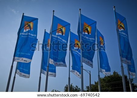 MELBOURNE, AUSTRALIA - JANUARY 22: Group of flags outside the Rod Laver Arena which holds the center court at the Australian Open, January 22, 2011 in Melbourne, Australia