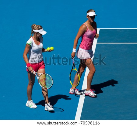 MELBOURNE, AUSTRALIA - JANUARY 28: Maria Kirilenko (R) & Victoria Azarenka in the women's doubles final at the Australian Open on January 28, 2011 in Melbourne, Australia - stock photo