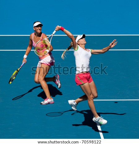 MELBOURNE, AUSTRALIA - JANUARY 28: Maria Kirilenko (R) & Victoria Azarenka in the women's doubles final at the Australian Open on January 28, 2011 in Melbourne, Australia
