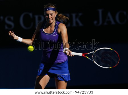 MELBOURNE, AUSTRALIA - JANUARY 26: Petra Kvitova of Czech Republic hits a return to Maria Sharapova of Russia during Australian Open tennis tournament, January 26, 2012 in Melbourne, Australia.