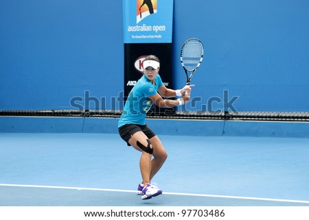 MELBOURNE, AUSTRALIA - JANUARY 21: WTA world number 4 tennis player Li Na hits on a practice court January 21, 2012 in Melbourne, Australia. Kim Clijsters defeated Na later in the day.