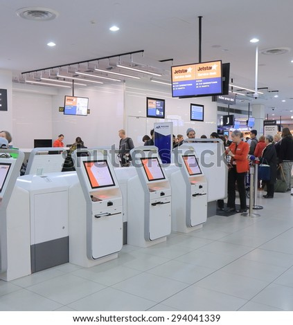 MELBOURNE AUSTRALIA - JUNE 18, 2015: Unidentified people check in at Jetstar check in counter at Melbourne airport. Qantas is the parent company of the low cost airline Jetstar