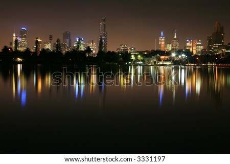Melbourne, Australia, on a still foggy night.  Skyline reflected in Albert Park Lake, location of Australian Formula 1 Grand Prix. - stock photo