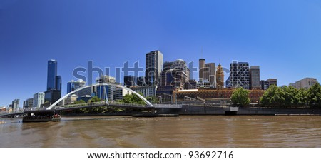 Melbourne City panoramic view from southbank over Yarra river to CBD skyscrapers and flinders station