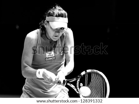 MELBOURNE - JANUARY 22: Agnieszka Radwanska of Poland in her quarter final loss to Li Na of China at the 2013 Australian Open on January 22, 2013 in Melbourne, Australia.