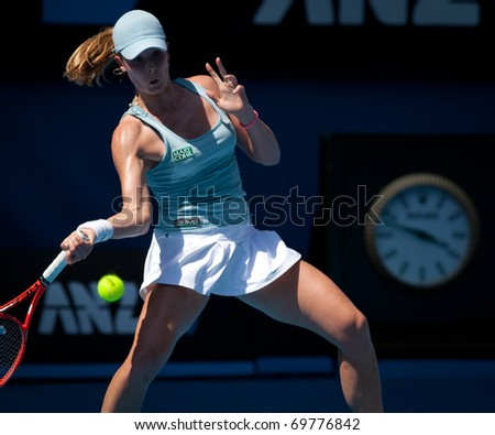 MELBOURNE - JANUARY 22: Alize Cornet of France in her third round loss to Kim Clijsters of Belgium in the 2011 Australian Open - January 22, 2011 in Melbourne