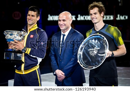 MELBOURNE - JANUARY 27: Andre Agassi poses with Novak Djolovic (L) of Serbia with the trophy for winning the 2013 Australian Open and Andy Murry  (R) on January27, 2013 in Melbourne, Australia.