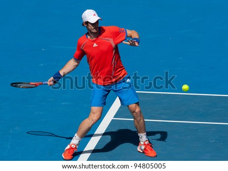 MELBOURNE - JANUARY 25: Andy Murray of Great Britain in his quarter final win over Kei Nishikori of Japan at  the 2012 Australian Open on January 25, 2012 in Melbourne, Australia.