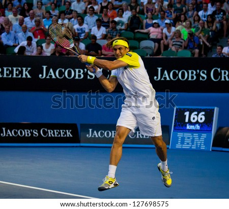 MELBOURNE - JANUARY 24: David Ferrer of Spain in his quarter final loss to Novak Djokovic of Serbia at the 2013 Australian Open on January 24, 2013 in Melbourne, Australia.