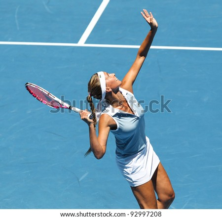 MELBOURNE - JANUARY 17: Gisela Dulko of Argentina in her first round loss to Maria Sharapova of Russia at the 2012 Australian Open on January 17, 2012 in Melbourne, Australia.