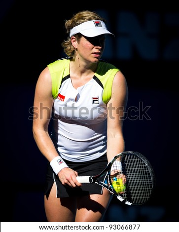 MELBOURNE - JANUARY 16: Kim Clijsters of Belgium in her first round win over Maria Joao Koehler of Portugal at the 2012 Australian Open on January 16, 2012 in Melbourne, Australia.