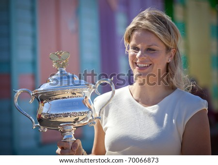 MELBOURNE, - JANUARY 30: Kim Clijsters of Belgium poses with the Daphne Akhurst Trophy at Brighton Beach after winning the 2011 Women's Australian Open final - January 30, 2011 in Melbourne, Australia