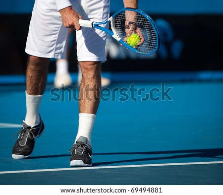 MELBOURNE - JANUARY 20: Legs of Radek Stepanek of the Czech Republic in his second round loss to John Isner of the USA  in the 2011 Australian Open - January 20, 2011 in Melbourne