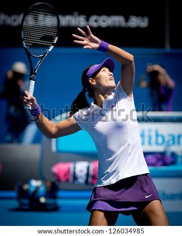 MELBOURNE - JANUARY 22: Li Na of China in her quarter final win over Agnieszka Radwanska of Poland at the 2013 Australian Open on January 22, 2013 in Melbourne, Australia.