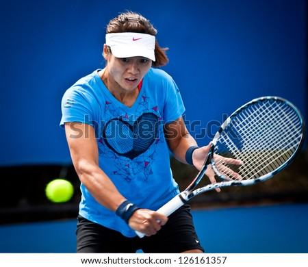 MELBOURNE - JANUARY 26: Li Na of China practices before the final at the 2013 Australian Open on January26, 2013 in Melbourne, Australia.