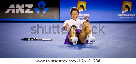 MELBOURNE - JANUARY 26: Li Na of Chins injures her ankle in the 2013 Australian Open Womens Final on January26, 2013 in Melbourne, Australia.
