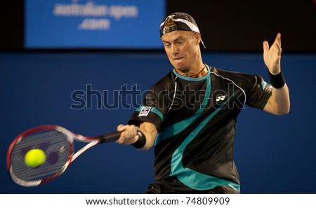 MELBOURNE - JANUARY 18: Lleyton Hewitt of Australia in his first round loss to David Nalbandian of Argentina in the 2011 Australian Open on January 18, 2011 in Melbourne, Australia.