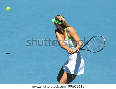 MELBOURNE - JANUARY 17: Maria Sharapova of Russia in her first round win over Gisela Dulko of Argentina the 2012 Australian Open on January 17, 2012 in Melbourne, Australia. - stock photo