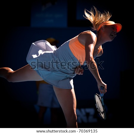 MELBOURNE - JANUARY 19: Maria Sharapova of Russia in her second round win over Virginie Razzano of France in the 2011 Australian Open - January 19, 2011 in Melbourne