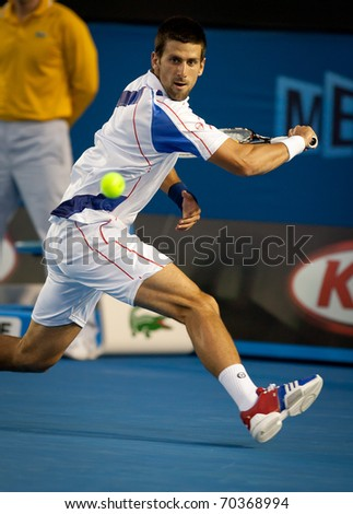 MELBOURNE - JANUARY 25: Novak Djokovic of Serbia in his quarter final match against  Tomas Berdych  on his way to the 2011 Australian Open final.  January 25, 2011 in Melbourne, Australia.